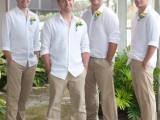 everyone wearign tan pants, white shirts and sandals to feel comfortable and not too hot