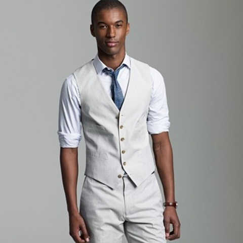 a creamy suit with a waistcoat, a white shirt and a blue tie will give you a laconic and stylish look