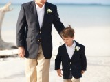 tan pants, a black jacket, a white shirt and boutonniere will suit not only a grown up guy but also a smaller one