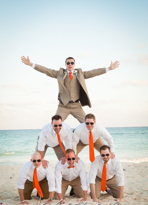 a taupe suit, a white shirt, an orange tie is a cool and contrasting outfit to rock