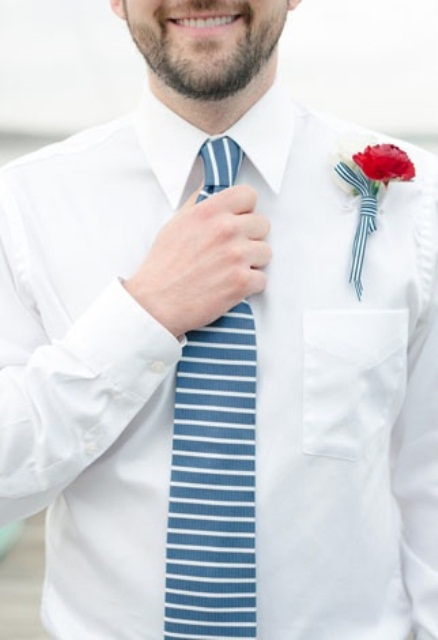 pull off stripes for a touch of nautical theme in your groom's look like here
