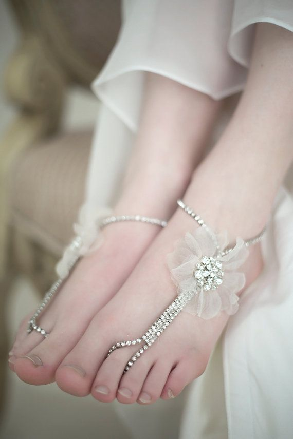 fully embellished barefoot wedding sandals with a tulle flower on one side are glam and super cute