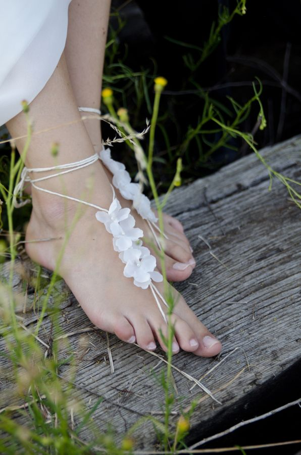 delicate lace up floral barefoot sandals are amazing for boho beach brides or for garden ones
