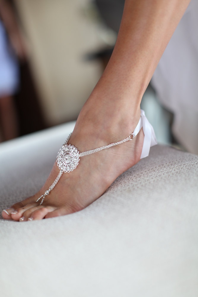 embellished barefoot wedding sandals with a macrame coin of shiny thread look chic and cool