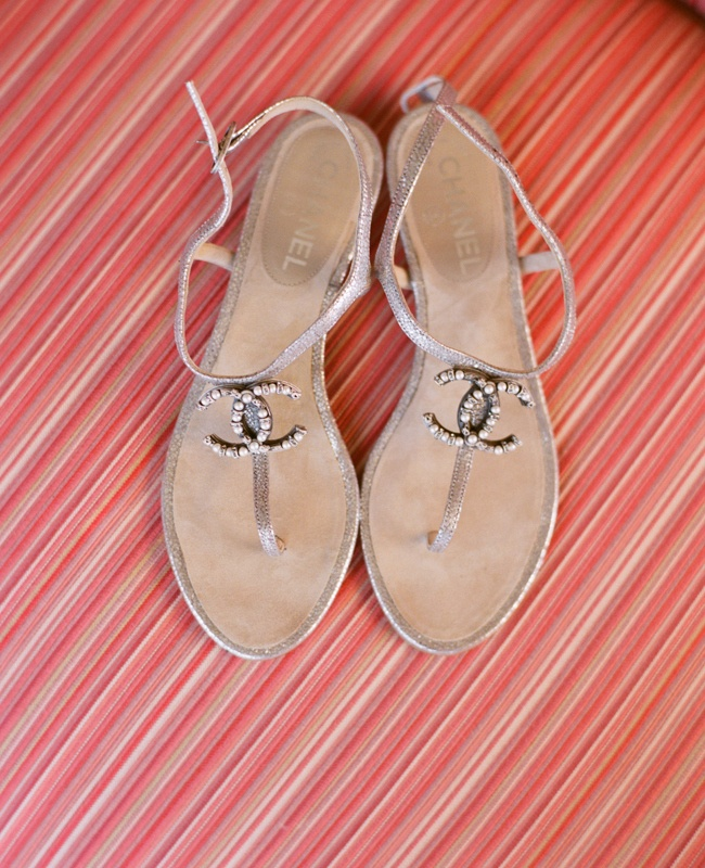flat siny sandals with Chanel logos are a timeless idea for a beach bride and they can be worn after the wedding, too