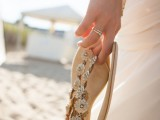 flat beach sandals decorated with fabric flowers are a nice solution for a beach bride