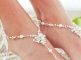delicate pearl and bead barefoot sandals are a romantic accessory for a beach bride
