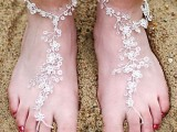 fully embellished barefoot beach wedding sandals with floral patterns look veyr chic and very cool