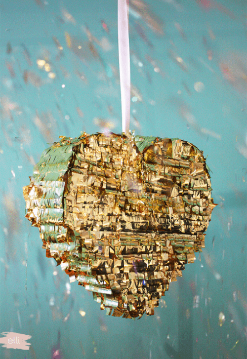 Cool DIY Shiny Gold Fringe Piñata To Make For Any Wedding Party