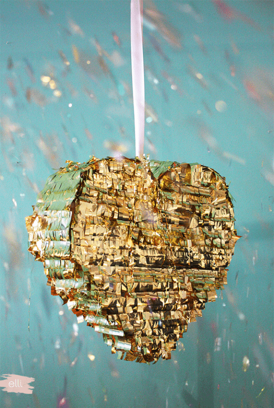 Picture Of cool diy shiny gold fringe pinata to make for any wedding party  4