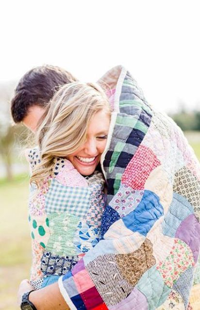 a cute and colorful patchwork blanket from your home will be a nice personal touch to your engagement pics