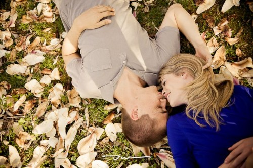 a romantic pic on the ground with petals and leaves is always welcome for any engagement season