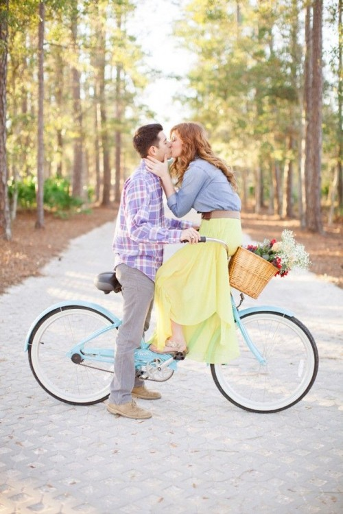 incorporate your favorite activities, for example, riding a bike, into your engagement photo shoot