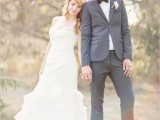a vintage-inspired groom's look with a grey suit, a white button down and a black bow tie