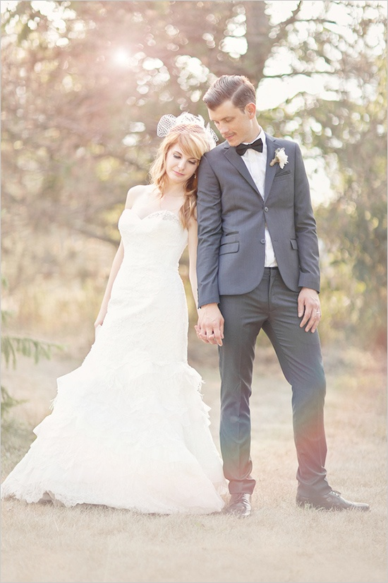 a vintage inspired groom's look with a grey suit, a white button down and a black bow tie