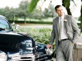 a vintage-inspired groom's outfit with a grey suit and tie, a white shirt and black shoes