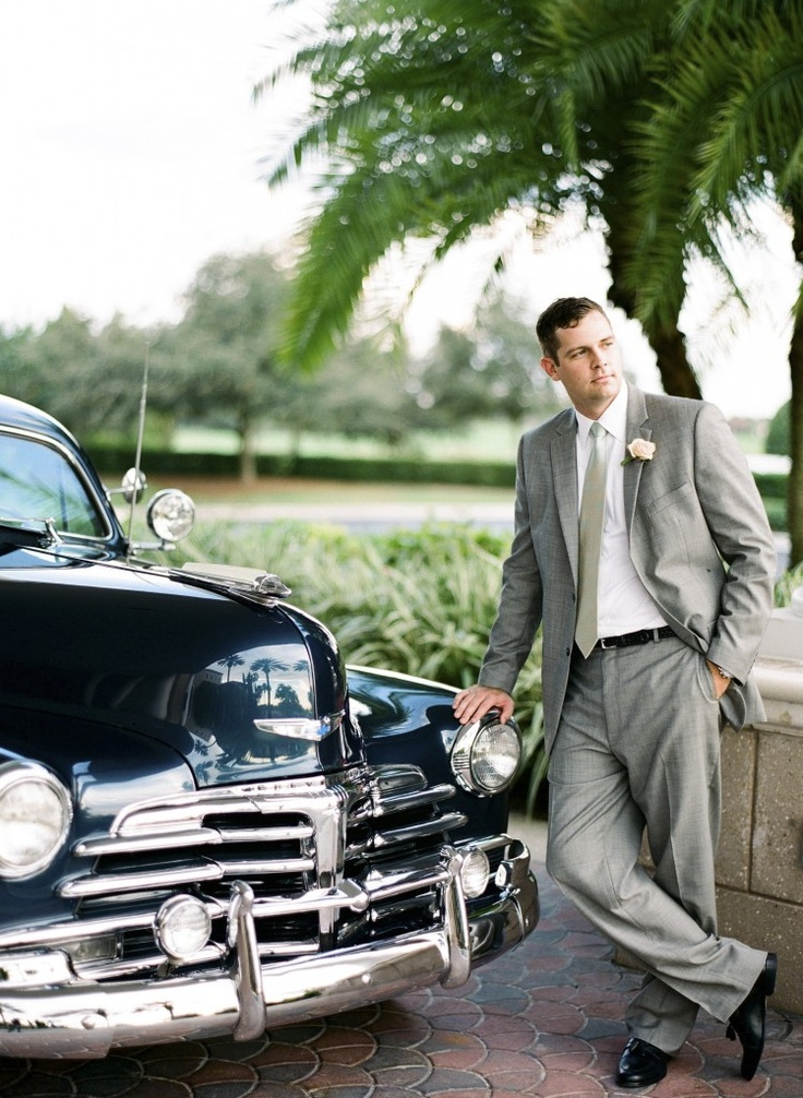 a vintage inspired groom's outfit with a grey suit and tie, a white shirt and black shoes