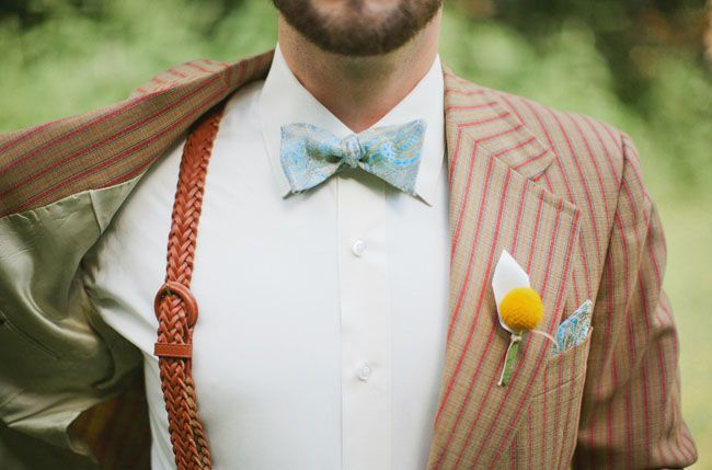 a vintage outfit with a rust striped suit, a blue printed bow tie and rust woven suspenders