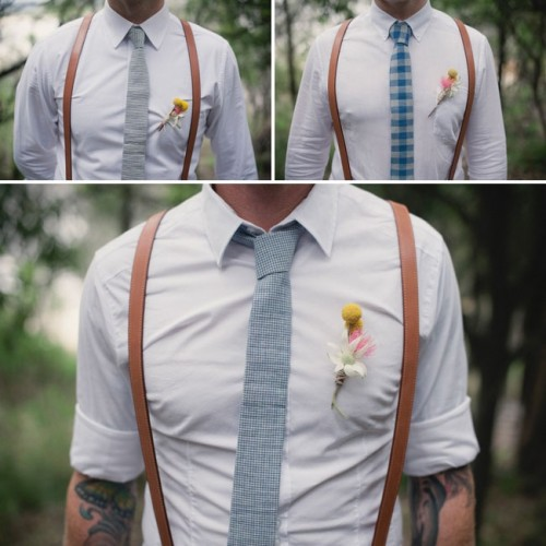 a stylish vintage-inspired outfit with a white button down, a blue printed tie and amber leather suspenders