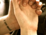 wedding date tattoos done with Roman numbers and placed on the wrists for a cool look