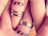 wedding bands and tiny date tattoos made with usual numbers on the back side of the fingers