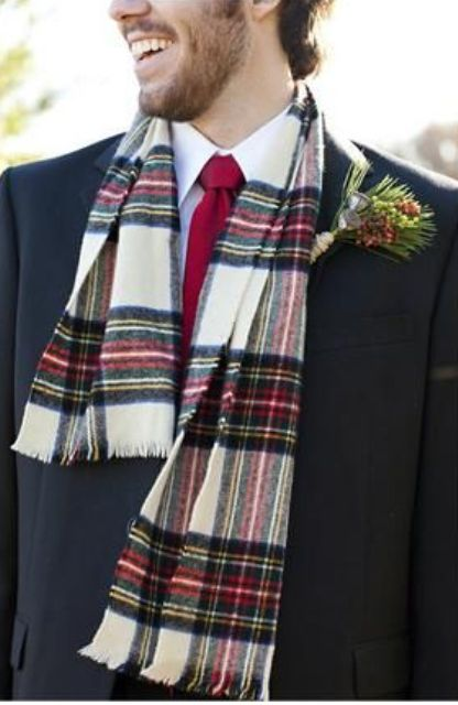 a navy suit, a white button down, a red tie and a checked scarf as a catchy winter accessory