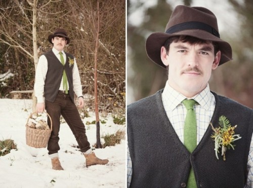 a catchy boho groom's look with black jeans and a knit waistcoat, a white printed button down, a green tie, brown boots and a brown hat