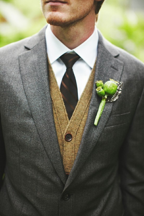 a grey suit, a tan cardigna, a white button down and a burgundy striped tie