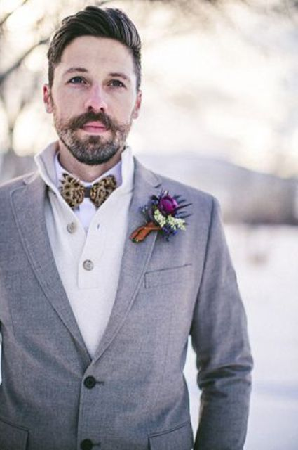 a grey tweed suit, a creamy cardigan, a white button down, an animal print bow tie plus a bright boutonniere