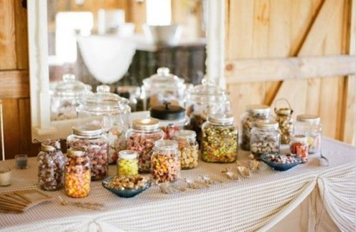 a sweets bar with colorful candies and popcorn is a cool idea for a fall bridal shower and won't break the bank