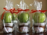 caramel dip in jars topped with fresh apples is a very fall-like treat idea that your guests will love