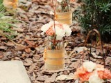 fall bridal shower or wedding decor with mason jars wrapped with burlap and bright fall blooms