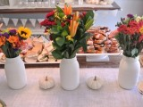simple bright fall bridal shower centerpieces of bold blooms and lush greenery will fit a fall wedding, too