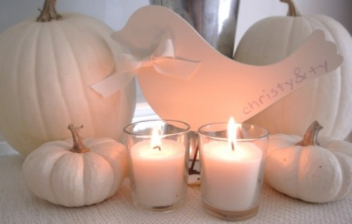 white pumpkins and candles are a chic and stylish decor idea for a neutral fall bridal shower
