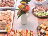 accent your buffet with bright floral centerpieces to embrace the season