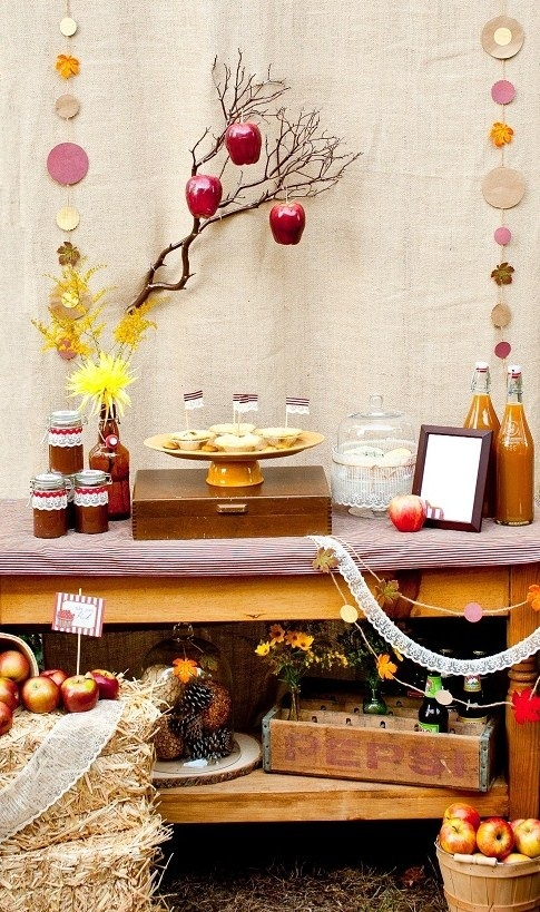 a fall bridal shower bar or station with fall drinks, tarts and apples plus apple, bloom and foliage decor