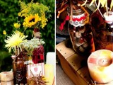 a fall bridal shower station decorated with fall blooms and bright candles