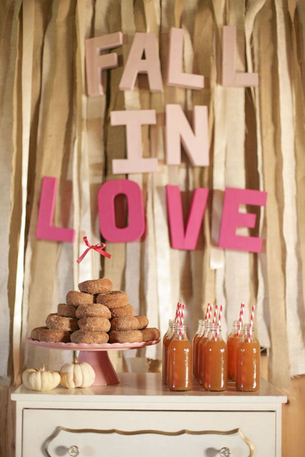 a cute fall bridal shower bar with apple cider and cinnamon donuts is right what you need for your party