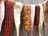 a garland of corn husks and cobs is a great rustic fall decoration for any event or party you are having