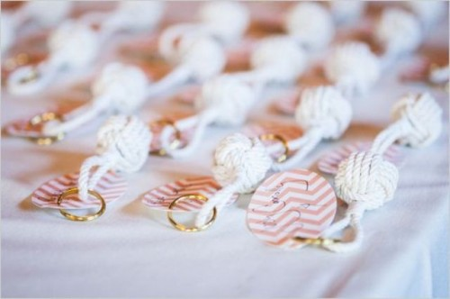large rope knots with chevron escort cards is a cool wedding seating chart for a beach or coastal wedding