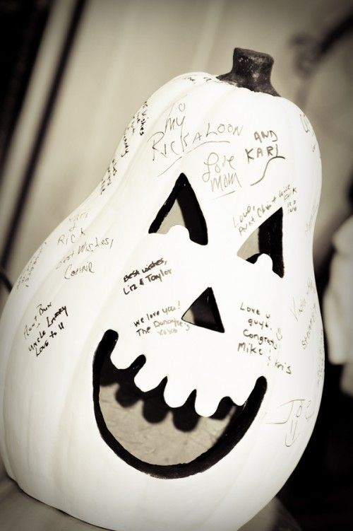 a faux white pumpkin with a cutout face is a perfect idea for a Halloween wedding