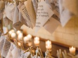 pieces of paper and cardboard attached to the ropes with clothespins and some candles around