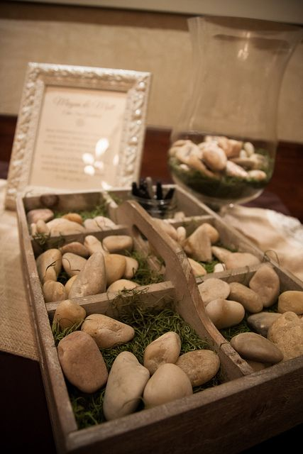 a wooden box with moss and pebbles, on which the guests can leave messages and wishes