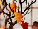 tree branches with bright fall leaves of paper is a creative and simple idea for  fall wedding guest book
