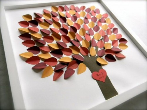 a simple framed wedding guest book with colorful paper leaves is a stylish idea