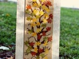 a frame with a tree with colorful paper leaves is a simple and creative DIY for the fall
