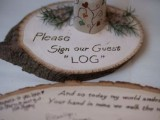 a wood slice with calligraphy and some fir branches is a stylish rustic idea for a fall wedding