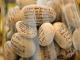 a glass jar with pebbles can be a nice idea not only for a fall wedding but also for other weddings, too
