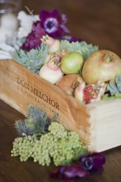 a rustic crate with lots of real fresh vegetables is a perfect centerpiece for a rustic wedding