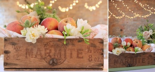 an industrial crate with peaches is a cool idea of a centerpiece for a southern wedding